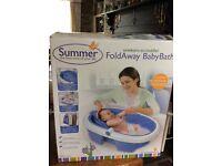 Folding baby bath.