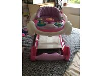 Girls baby walker it's pink and look like a Minnie car