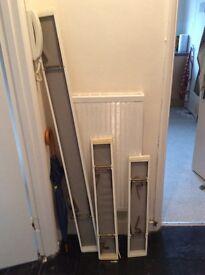 Three white clip- on radiator shelves covers £25 ONO