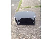 Dark glass TV stand in stunning condition for sale.