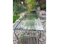 Glass Top, Black Metal Framed Coffee Table. Stylish, good size for most rooms or even patio area's.