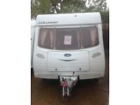 Lunar quasar eb 2005 4 berth fixed bed with motor mover