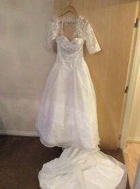 stunning white full length wedding dress with train and bolero