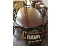 Mahogany finish Dining table and six padded chairs including two carvers.
