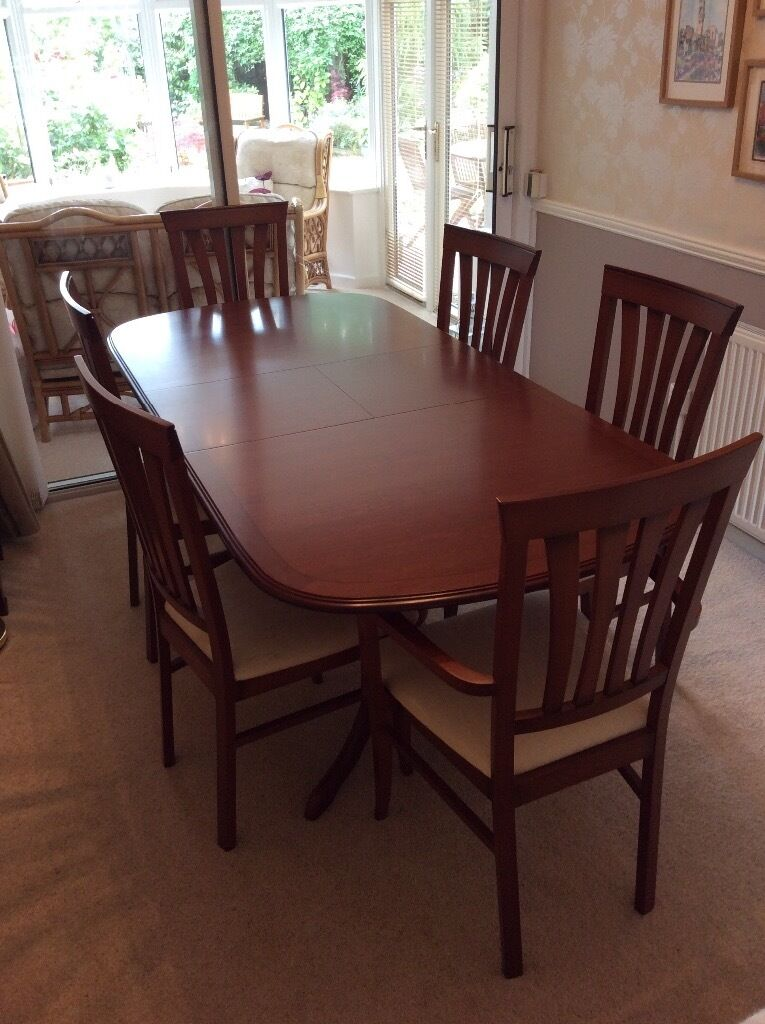 Walnut dining table and chairs nest of tables