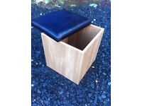 Cube shaped storage box/blanket box and seat on castors