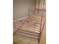 Pink metal single bed frame.