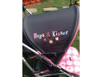 Hugs & kisses baby stroller with covers in good condition.