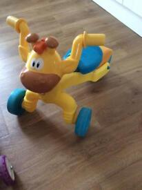 Child's giraffe ride on