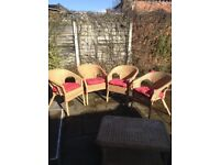 4 Wicker chairs with cushions. Suitable for garden or conservatory.
