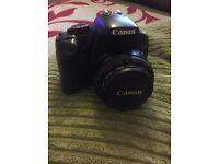 Canon eos 450D digital camera and three lenses, also camera bag