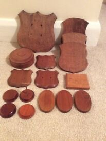 Assorted wooden shields / plaques for mounting and stands for models