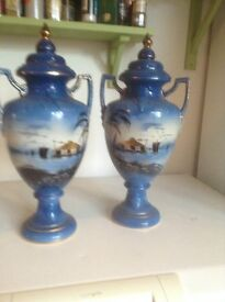 Beutiful pair of hand painted ornamental mantlepiece urns