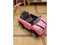 Mini push along car. Pink like tiny tikes