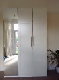 White IKEA Wardrobe with mirror door. 238cm high, 150cm wide and 60cm deep