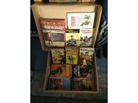 Box of Western paperback novels.