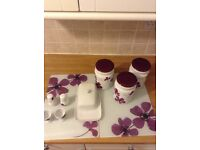 A NICE PURPLE KITCHEN CANISTER SET.