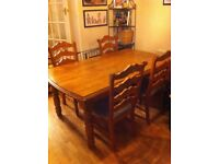 Quality DFS dining table and 6 chairs cost £1100