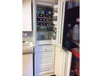 Frost free fridge freezer in cream kitchen housing