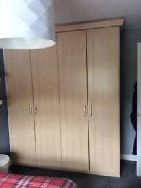 Large fitted wardrobes in beech
