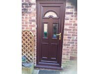 External Kitchen PVC Door half glass as per photo . Mahogany in colour includes frame