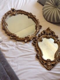 One large and one small decorative mirror