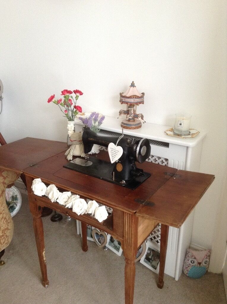 Lovely shabby chic sewing machine that can be stored into the tablein Hull, East YorkshireGumtree - Lovely shabby chic sewing machine this is electric I have the leads dont no if it works I only use it for show .the flaps at the end of the table unscrew and come off its to long lovely piece of vintage furniture