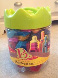 Stackadoos bristle building blocks. 68 chunky soft pieces easy to connect with little hands!