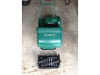 Qualcast Classic Electric 30S Heavy Duty Lawnmower with separate Scarifier