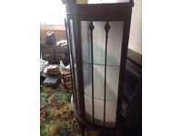 Bow fronted glass display unit