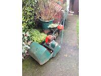 """Suffolk punch 14"""" cylinder petrol lawn mower."""
