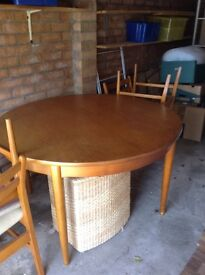 Teak round dining table and 6 matching chairs