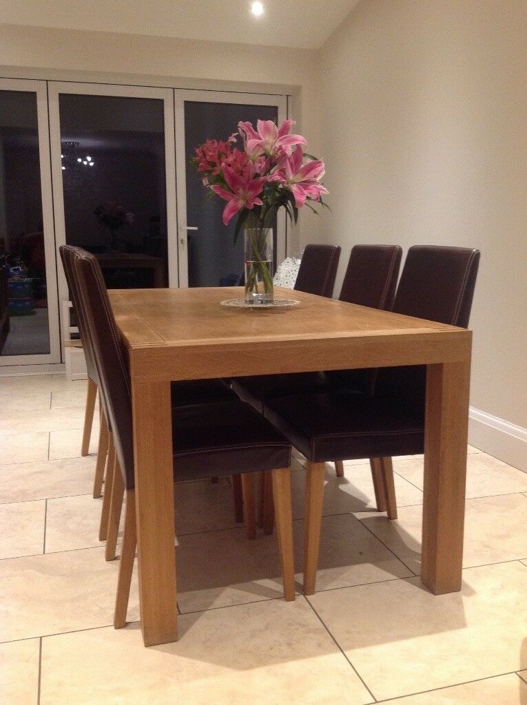 Solid oak dining table and brown leather chairs, v good condition. Matching sideboard also available