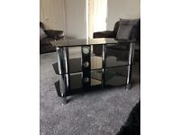 "Black glass and chrome TV stand. Excellent condition. Suitable for 32"" TV's"