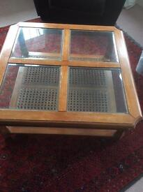 Coffee glass occasional table with rattan base