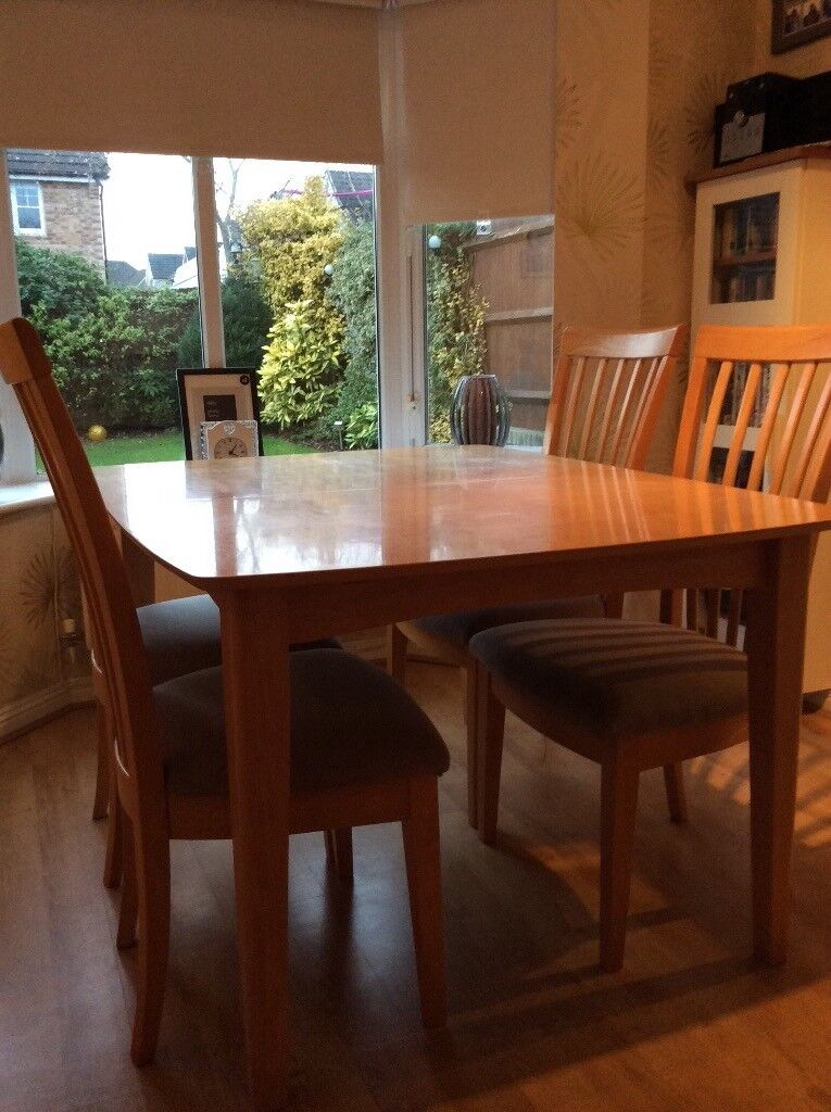 Large Extendable Modern Beech Dining table including 6 chairs, 2 are carver design