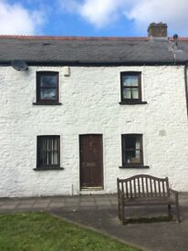 2 bedroomed cottage on outskirts of Merthyr 2 mins A 470 5 mi walk to train 2 mins walls to bus top