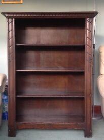 Ercol Dark Oak Bookcase. 4 x shelves. Measures 122cm high x 86cm wide.