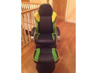 Green and black gaming chair and footstool