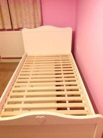 White single bed, with under bed storage
