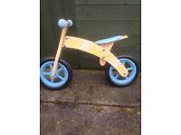Childs wooden balance bike.