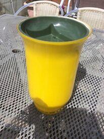 Glass vase for flower arranging.