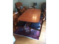 Dining table and four chairs. Drop leaf bought in 1972 and in very good condition.