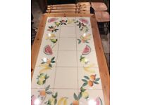 Tiled pine table & four green rattan seat chairs
