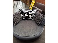 3 seater sofa and a spinning snuggle chair, fabric and leather colour black/ grey