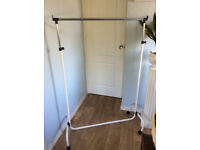 "CLOTHES RAIL 38"" LONG. THE HEIGHT ADJUSTABLE"