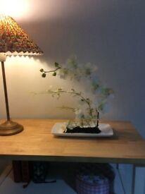 Beautiful new elegant orchid silk flower arrangement on a white porcelain tray
