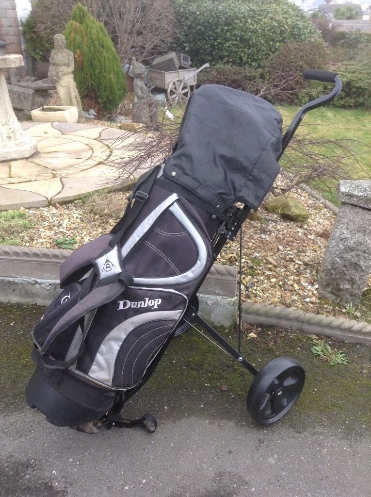 Dunlop golf trolleyBag. Golf clubsin Liskeard, CornwallGumtree - Dunlop golf trolley, Dunlop golf bag , plus several golf clubs. Please check photos, as I have no idea what they are used for. Three have Dunlop fluffy padded covers. All seem in good condition. I think there are 14 clubs