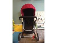 Complete Mothercare Roam Travel System with fuchsia accents and isofix base