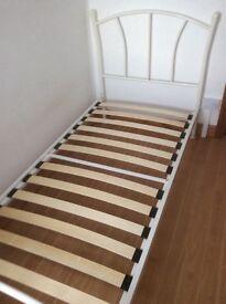 Lovely white single bed frame for girls room.